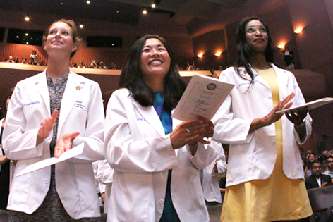 Dr. Howard J. Federoff with student at white coat ceremony.