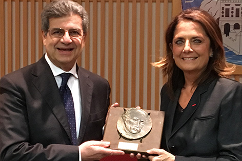 Professor Emiliana Borelli holds the Golgi Medal with Professor Enrico Agabiti Rosei, president of Italy's Golgi Foundation.